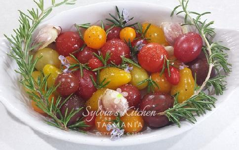 Mixed Heirloom Tomatoes and Garlic ready to be oven roasted